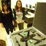 Two members of the ACT Makers Club, with the custom drone by another member
