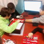 tags/children playing with robotics in a Greek NGO